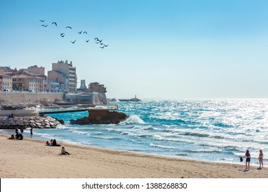 MARSEILLE, FRANCE - 25.03.2019: Sunny day on the beach in Marseille, Plage des catalans, France