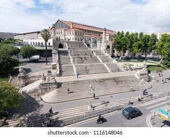 marseille, france, 4 june 2018: people climb the stairs to marseille Saint-Charles railway station on sunny day