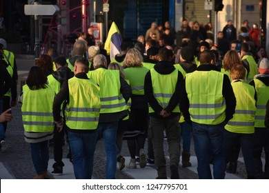"Marseille, France - December 01, 2018 : Demonstrators with yellow vests (""gilets jaunes"" in french) protest against the increase of fuel cost, excessive living costs and high rate of taxes"