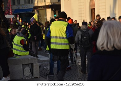 """Marseille, France - December 01, 2018 : Demonstrators with yellow vests (""""gilets jaunes"""" in french) protest against the increase of fuel cost, excessive living costs and high rate of taxes"""