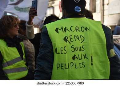 "Marseille, France - December 08, 2018 : Demonstrators with yellow vests (""gilets jaunes"" in french) protest against the increase of fuel cost, excessive living costs and high rate of taxes"