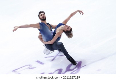 MARSEILLE, FRANCE - DECEMBER 10, 2016: Gabriella PAPADAKIS and Guillaume CIZERON of France during Free Dance at the ISU Grand Prix Final in figure skating in Palais Omnisports Marseille