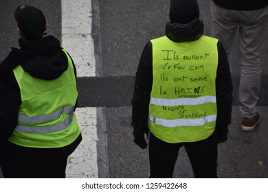"""Marseille, France - December 15, 2018 : Demonstrators with yellow vests (""""gilets jaunes"""" in french) protest against the increase of fuel cost, excessive living costs and high rate of taxes"""