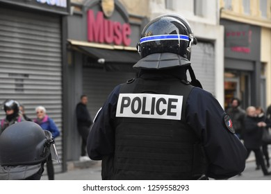 Marseille, France - December 15, 2018: French gendarmes and police block protesters during a demonstration