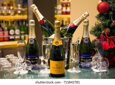 MARSEILLE, FRANCE - DECEMBER 22, 2016. Luxury champagnes Veuve Clicquot, Moët & Chandon & Nicolas Feuillatte with flutes and a Christmas tree background. Christmas party. New Year's eve celebration