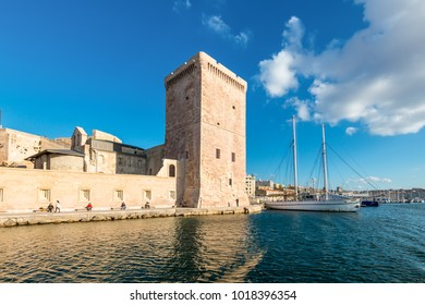 Marseille, France - December 4, 2016: View from the sea to the Fort Saint-Jean and traditional rig sailing ship Noctilio in Marseille, Provence, France.