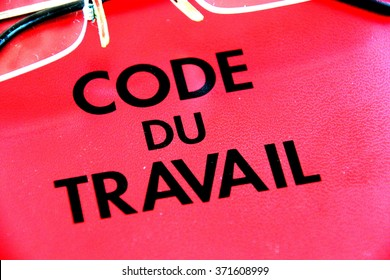 Marseille, France - February 03, 2016 : A French labor code book is pictured with a pair of glasses