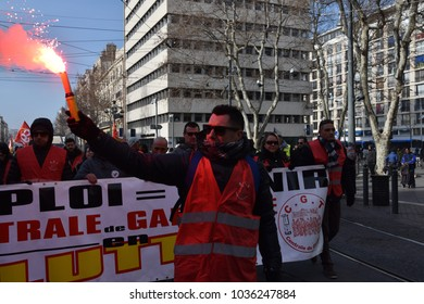 Marseille, France - February 22, 2018 : A torch is seen as, at the call of the CGT, hundreds of union workers and allies gather in the streets of Marseille, France to demonstrate against the austerity