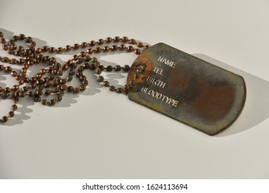 Marseille, France - January 09, 2020 : Old military identification plate and its necklace