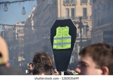 """Marseille, France - January 12, 2019 : Demonstrators with yellow vests (""""gilets jaunes"""" in french) protest against the increase of fuel cost, excessive living costs and high rate of taxes"""