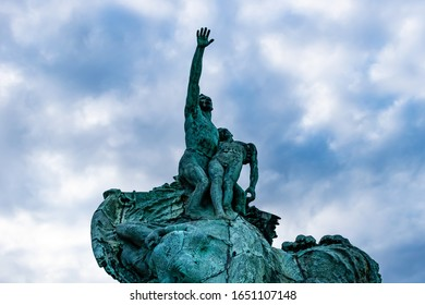 Marseille, France - January 25, 2020: The Monument to the heroes and victims of the sea (Monument aux héros et victimes de la mer) installed next to the Pharo Palace against the cloudy sky