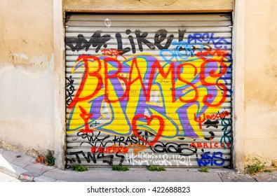 MARSEILLE, FRANCE - JUL 18, 2014: Old graffiti text on a garage door in the center of Aix-en-provence