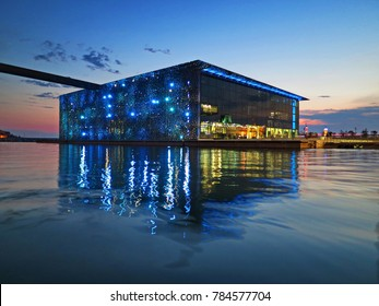 MARSEILLE, FRANCE - JULY 09, 2015 : Building of Museum of European and Mediterranean Civilizations (MuCEM) reflecting in water at the evening.