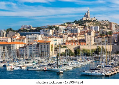 MARSEILLE, FRANCE - JULY 12, 2014: Aerial panoramic view on basilica of Notre Dame de la Garde and old port  in Marseille, France