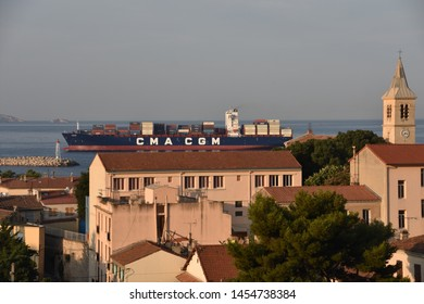 """Marseille, France - July 18, 2019 : The """"Alexis"""" container ship of the company """"CMA-CGM"""" enters the port of Marseille"""