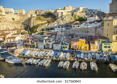 MARSEILLE, FRANCE - JULY 9, 2015 : Fishemen boats in a small harbor. The Vallon des Auffes is a small fishing port of the 7eme district of Marseille, France.
