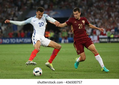 MARSEILLE- FRANCE, JUNE 2016 :Alli and Shenninkov in action  during football match  of Euro 2016  in France between England vs Russia at the Stade Velodrome   on June 11, 2016 in Marseille.
