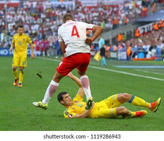MARSEILLE, FRANCE - JUNE 21, 2016: Thiago Cionek of Poland (L) fights for a ball with Taras Stepanenko of Ukraine during their UEFA EURO 2016 game at Stade Velodrome in Marseille. Poland won 1-0