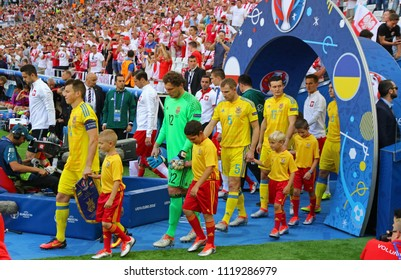 MARSEILLE, FRANCE - JUNE 21, 2016: Ukrainian (in Yellow) and Polish players go to the pitch before their UEFA EURO 2016 game at Stade Velodrome in Marseille. Poland won 1-0