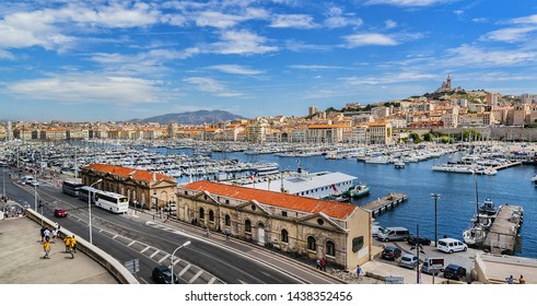 MARSEILLE, FRANCE - JUNE 21, 2016: View of the Vieux-Port with several boats moored in the marina of Marseille.