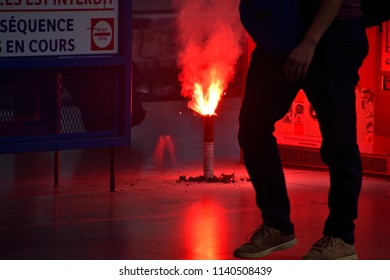 Marseille, France - June 28, 2018 : Railway workers burn flares as they hold a demonstration at Gare de Marseille Saint-Charles train station