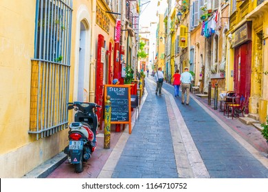 MARSEILLE, FRANCE, JUNE 9, 2017: A narrow street in the Le Panier district of Marseille, France