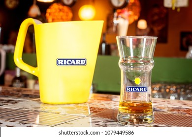 MARSEILLE, FRANCE - MARCH 15, 2018: Close of on a Ricard jug and a water bottle with its logo. Ricard is a pastis, an anise and licorice flavored aperitif typical from Southern France