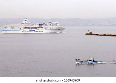 MARSEILLE, FRANCE - MAY 06 2008:Ferry enters Marseille port.It's the second-largest city of France located on the on the Mediterranean Sea and it's France's largest commercial port