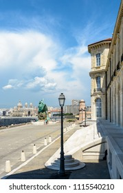Marseille, France - May 19, 2018: Rear of the Pharo palace with the monument to heroes and victims of the sea, a turret of the Saint-Jean fort and Sainte-Marie-Majeure cathedral in the background.