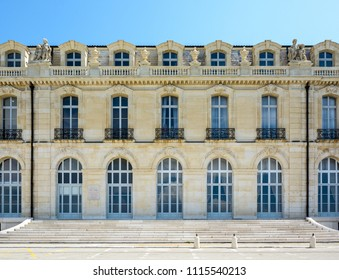 Marseille, France - May 19, 2018: View of the rear facade of the Pharo palace with marble stairs, french doors, windows balconies and statues.
