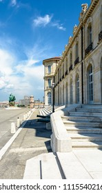 Marseille, France - May 19, 2018: View of the rear facade of the Pharo palace with the monument to heroes and victims of the sea and a turret of the Saint-Jean fort in the background.
