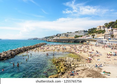 Marseille, France - May 19, 2018: People sunbathing and swimming on the Prophet beach, a very popular family beach located on the Kennedy corniche, on a hot and sunny spring day.