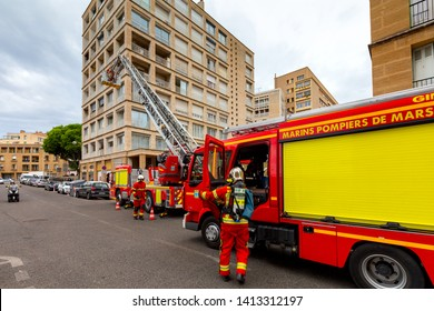 Marseille, France - May 19, 2019: Fire trucks and rescue teams work on a city street.