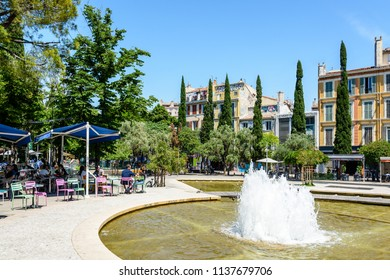 Marseille, France - May 23, 2018: View of the fountain of the cours Julien, a large pedestrian square very popular with Marseille young people where they can find bars and restaurants with terraces.