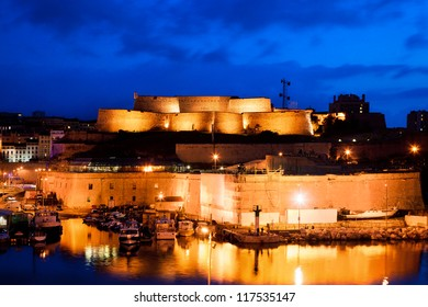Marseille, France at night. Part of Fort Saint-Jean at the harbour entrance.