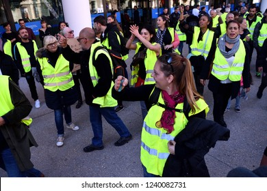 "Marseille, France - November 24, 2018 : Demonstrators with yellow vests (""gilets jaunes"" in french) protest against the increase of fuel cost, excessive living costs and high rate of taxes"