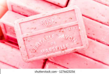 MARSEILLE, FRANCE - NOVEMBER 7, 2015: Marseille Soap stacked bars at weekly flea market - Handmade manufactures with organic oil of lavender flowers - Living coral filter