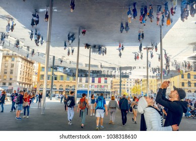 MARSEILLE, FRANCE - OCTOBER 01, 2017: View of modern mirrored awning at Vieux Port with people walking and looking at their reflection. Provence