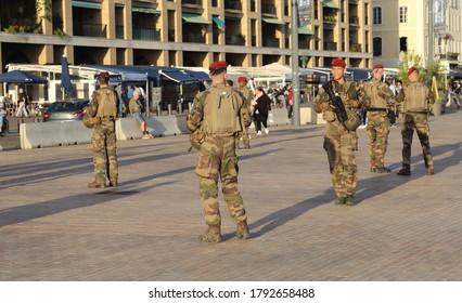 Marseille, France - October 3, 2019: Armed police on patrol in the old harbor of Marseille in Marseille, France on October 3, 2019