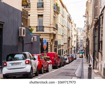MARSEILLE, FRANCE, on March 2, 2018. Buildings of traditional architecture make an attractive architectural complex of the street in a historical part of the city. Cars are parked near the sidewalk