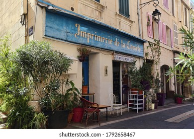 Marseille, France - September 28, 2019: Little cafe and potted plants in a narrow street in the old part of Marseille, France on September 28, 2019