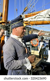MARSEILLE, FRANCE - SEPTEMBER 5: Sailor decorated with ancient garment on an old sailboat to explain to tourists the history of naviguation, September 5, 2015.