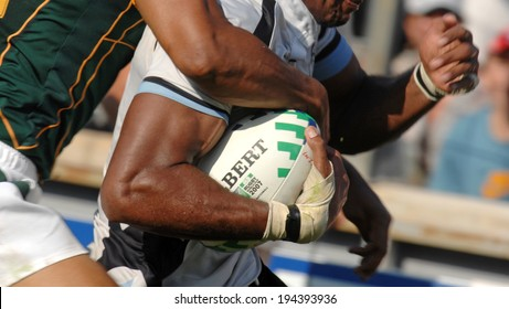 MARSEILLE, FRANCE-OCTOBER 07, 2007: Fijian player holds the ball, during the match Fiji vs South Africa, of the Rugby World Cup France 2007, in Marseille.