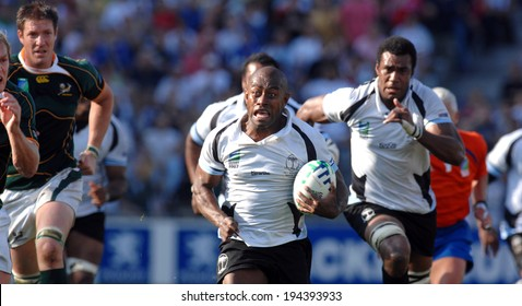 MARSEILLE, FRANCE-OCTOBER 07, 2007: rugby player Mosese Rauluni of Fiji, runs with the ball, during the match Fiji vs South Africa, of the Rugby World Cup France 2007, in Marseille.