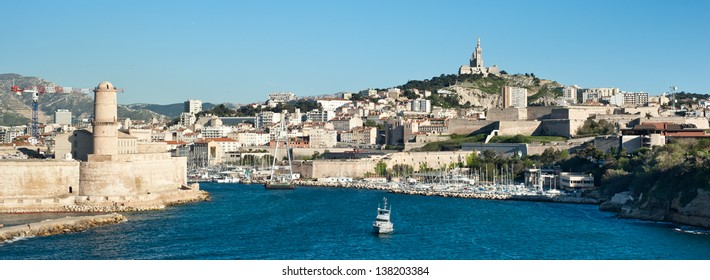 Marseille, Marsiglia, France skyline seen from the sea. Old port with boats, Notre Dame de la Garde, Fort Saint-Jean.