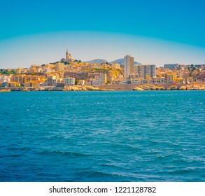 Marseille panorama from Frioul archipelago with sea water and waves in the forefront. Marseille, Provence-Alpes-Cote d'Azur, France.