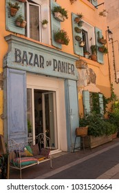 Marseille, Provence, France - June 17 2015 : Antique shop with plants hanging on the walls and shutters in Le Panier, Marseille