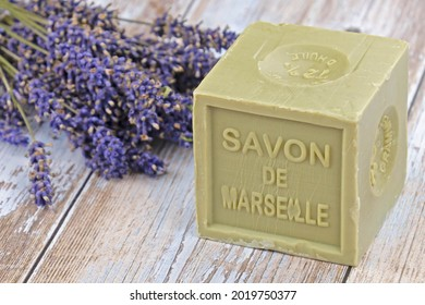 """Marseille soap with written on it in French """"Marseille soap"""" and lavender bouquet"""