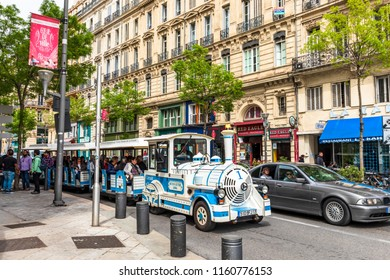 MARSEILLE,FRANCE-APRIL 14,2018 : Sightseeing car waiting for tourists near old building on the walking street at Marseille Vieux Port on the Mediterranean coast and the largest port for commerce