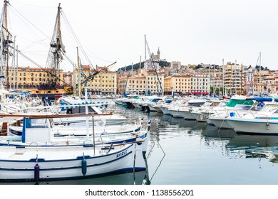 MARSEILLE,FRANCE-APRIL 14,2018 : View of yatchs in Marseille Vieux Port and Notre Dame de la Garde church  on the Mediterranean coast and the largest port for commerce